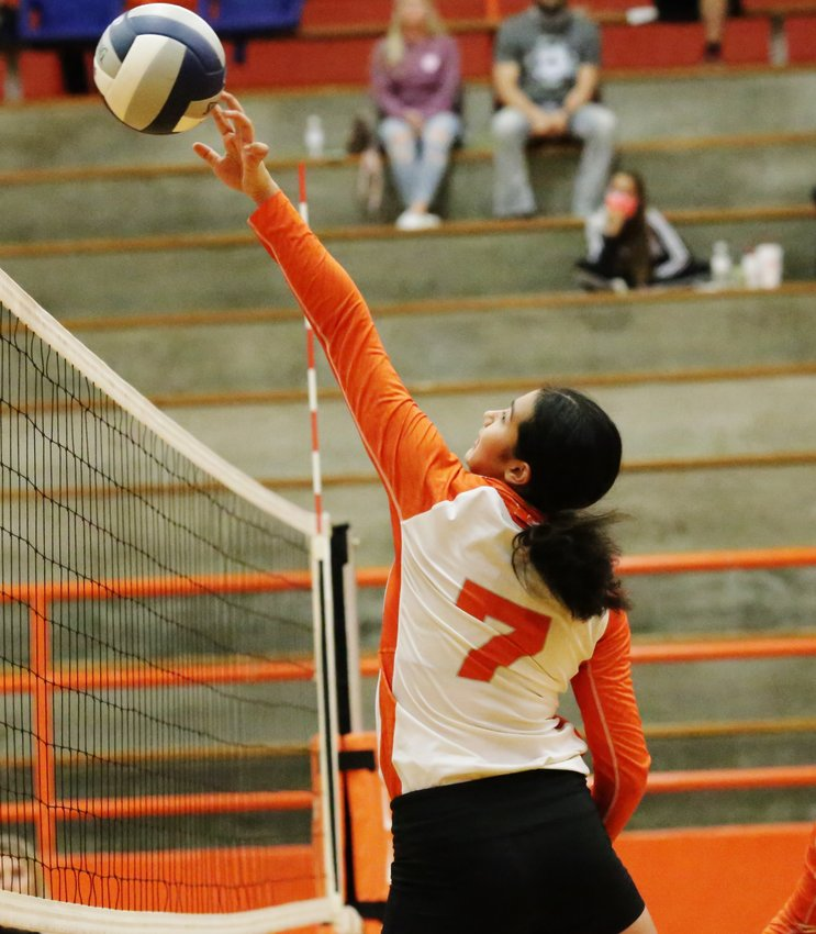 Lady Jacket Valerie Garcia makes a play at the net. (Monitor photo by John Arbter)