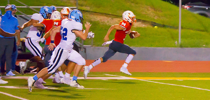 T.J. Moreland of Mineola sprints for daylight and a score after recovering a West Rusk fumble in Friday's 36-14 Mineola victory. (Monitor photo by Sam Major)