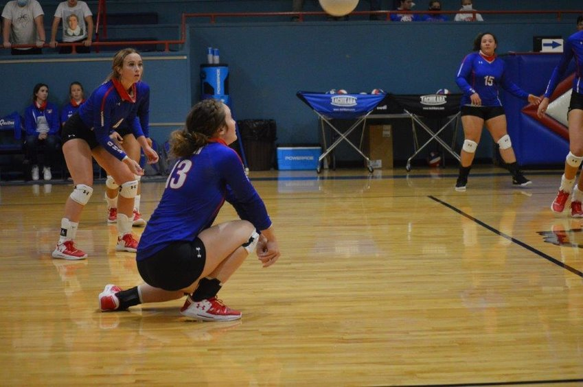 Quitman's Lucy Brannon (13) digs deep to return a Brownsboro kill attempt as teammate Lindsey Hornaday (4) backs her up. Quitman won the match in five sets. (Monitor photo by Larry Tucker)