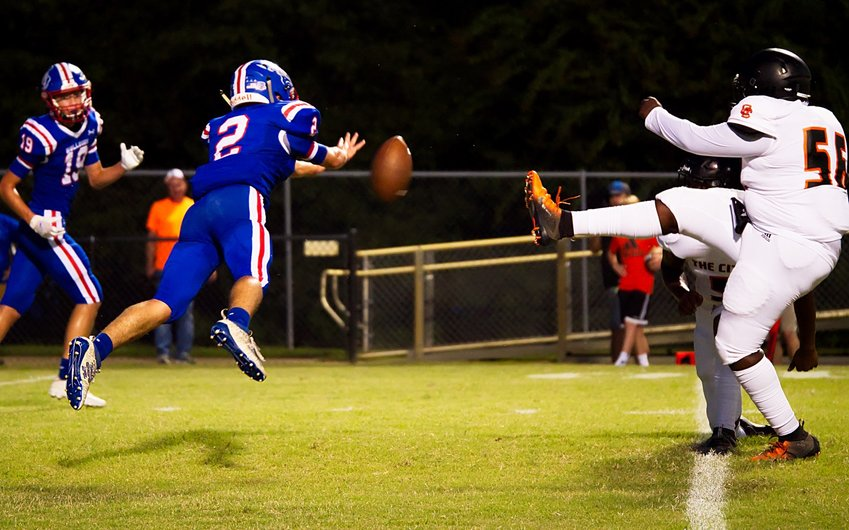 Ford Tannebaum blocks an extra point for Quitman Friday night against Queen City. The Bulldogs fell 65-13 in the homecoming game.