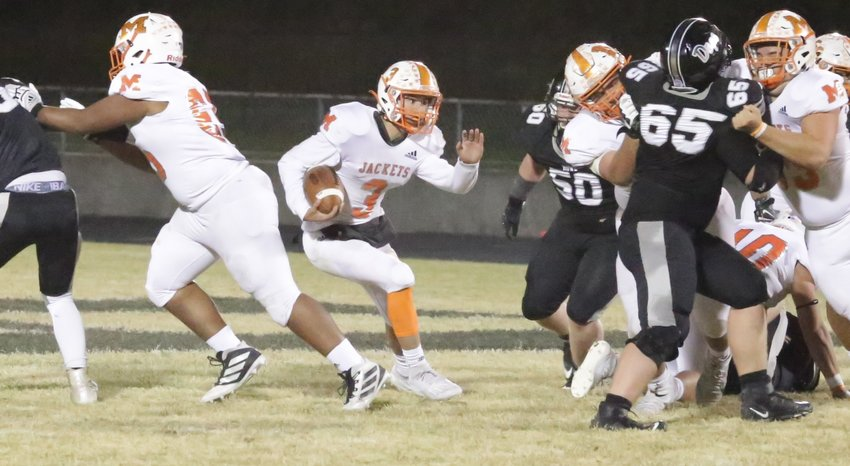 The Yellowjacket offensive line opens up options for quarterback T.J. Moreland. (Monitor photo by John Arbter)