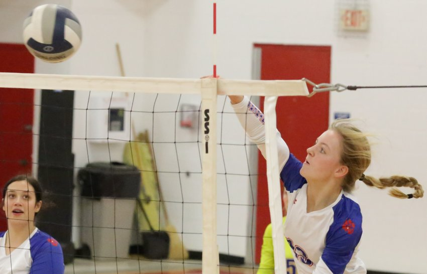 Cacie Lennon smashes the winning point in game two over North Hopkins. (Monitor photo by John Arbter)