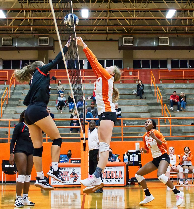 Mylee Fischer wins the battle at the net against her Chapel Hill opponent on Friday.
