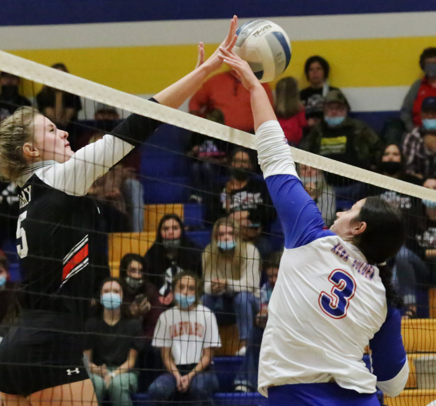 Lady Panther Kalli Wright challenges at the net.