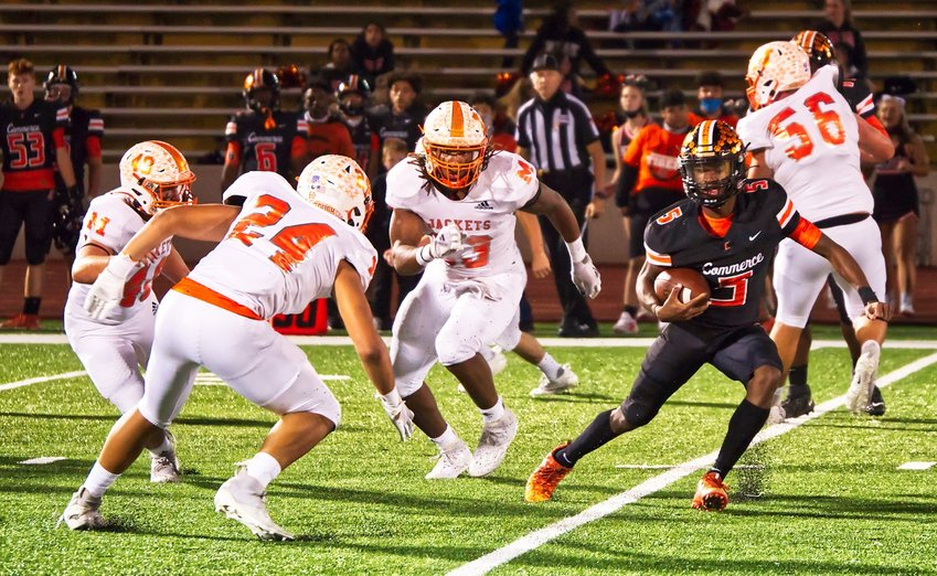 Hunter Wright, 40, Kobe Kendrick, 24, and Trevion Sneed have the crafty Commerce quarterback surrounded, with almost nowhere to run.