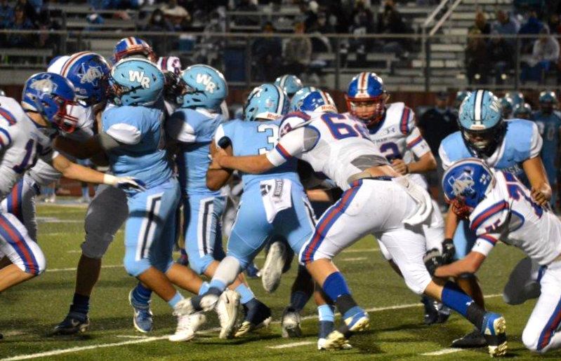 Quitman's Jonathan Lacy (62) fights through West Rusk blockers to make a stop in Friday's game.