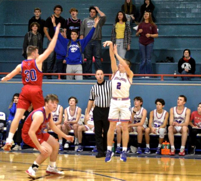 Quitman's Ford Tannebaum hits one of back-to-back successful three-point shots for Quitman to start the second half in the Bulldog win over Alba- Golden.