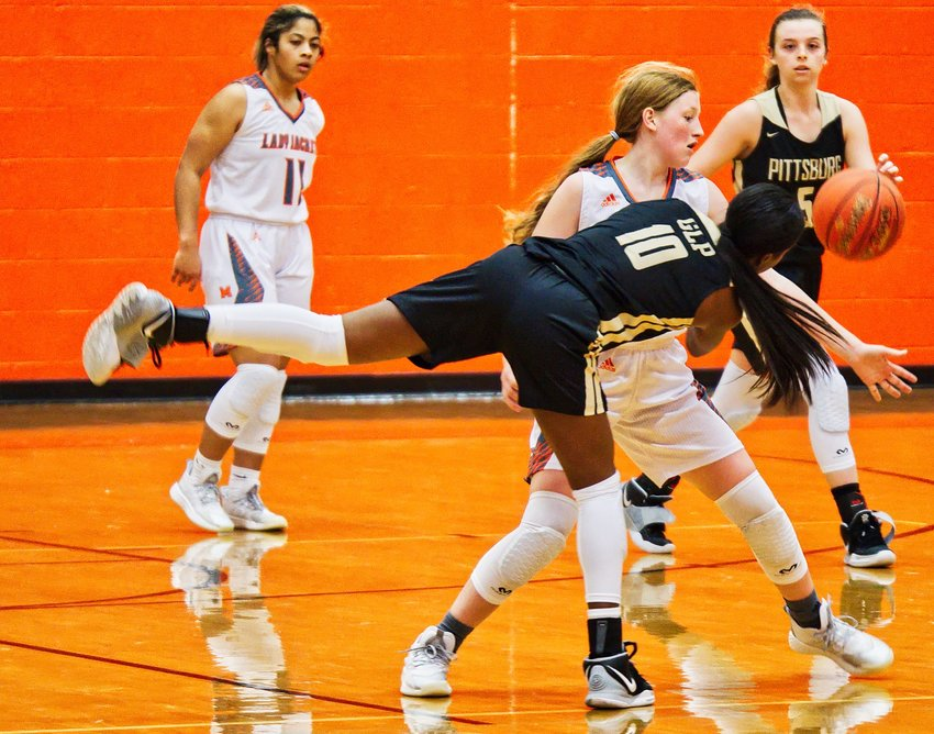 Macy Fischer plays tight defense, forcing a difficult pass.