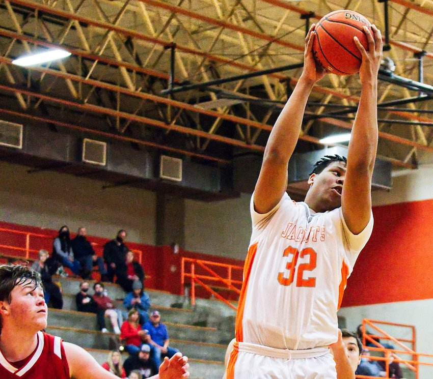 Stephen Ogueri (32) snags the rebound for Mineola in the Yellow jackets' 100-36 win over Harmony.
