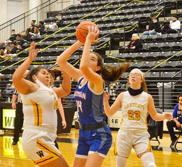 Quitman's Ava Burroughs (14) hits for two of her career high 32 points in the Lady Bulldogs' district win at Winona last Tuesday night. Burroughs also added 16 rebounds.