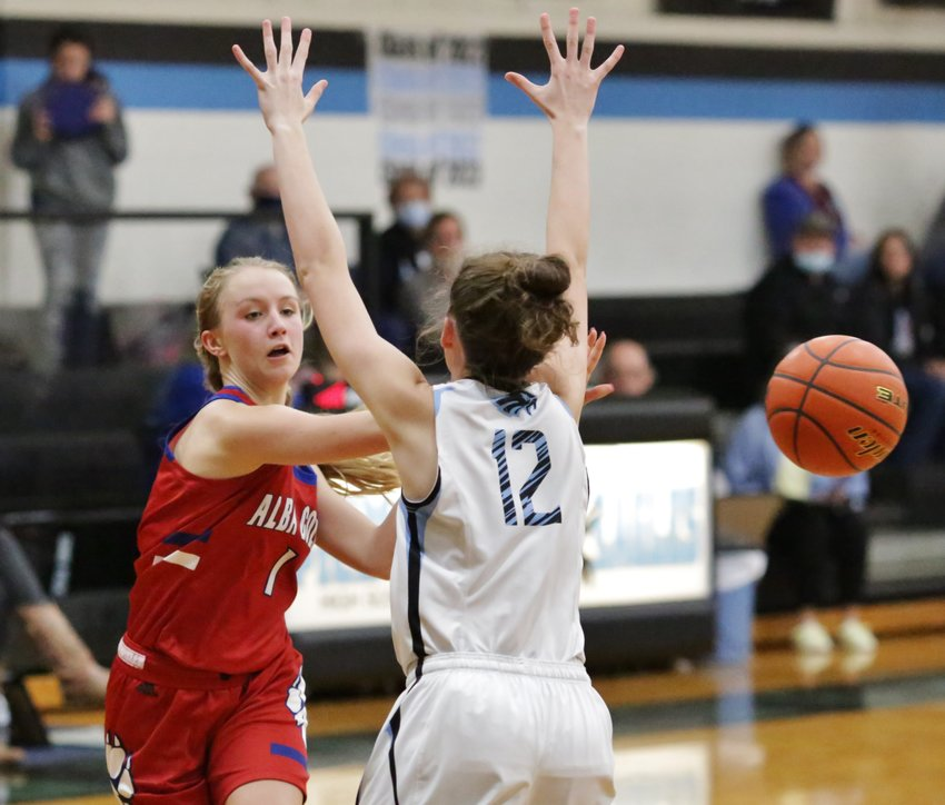 Lady Panther Bella Crawford dishes the ball to a teammate while leading a break in the win against Como-Pickton.