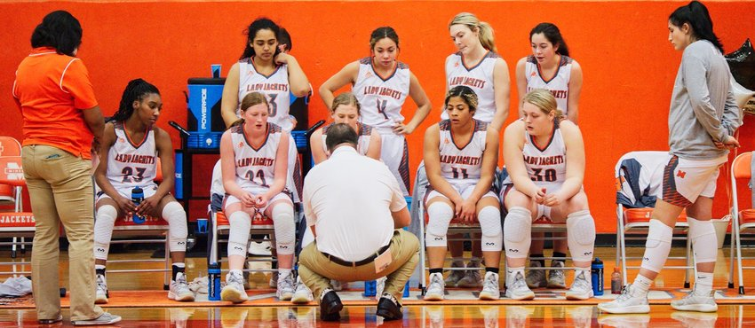 Coach Alan Wilson instructs the Mineola Lady Jackets during a time out in Friday's home game against Chapel Hill.