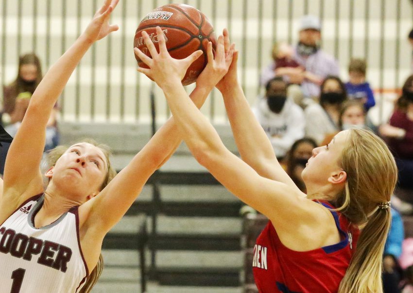 This scene accurately described the Class 2A District 15 title chase between Alba-Golden and Cooper early last week. By late Friday night, the Lady Panthers had claimed their crown. Bella Crawford, right, battles for Alba-Golden.