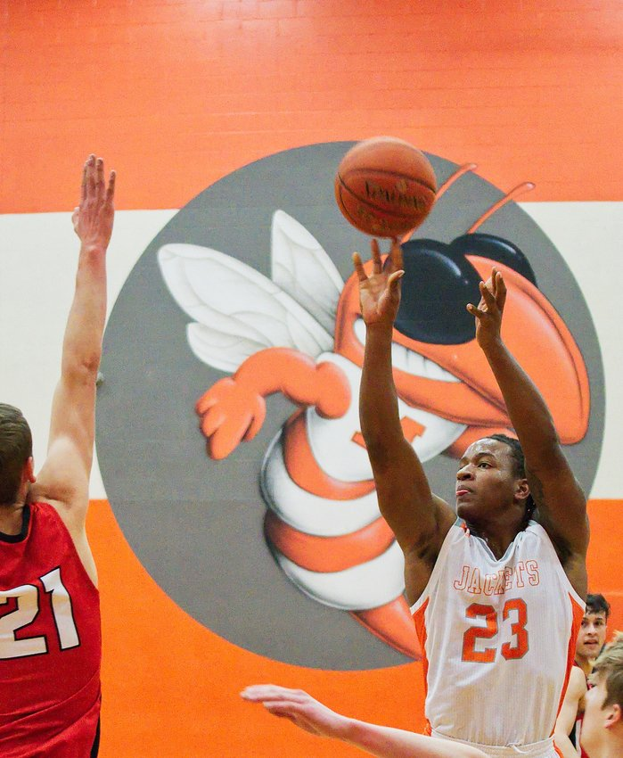 Trevion Sneed fires a jumper from the elbow.