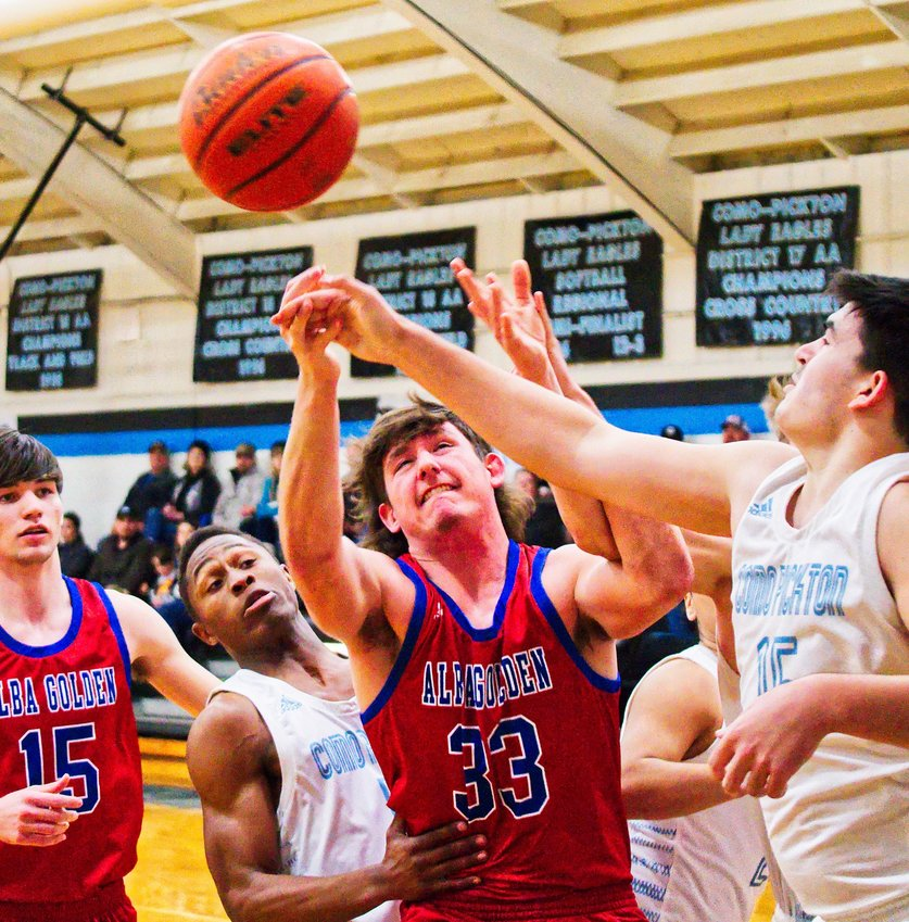 Boedy Baker of Alba-Golden battles for the ball with contact from three Como-Pickton players in the Panthers' game last Tuesday.