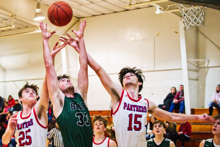 Kaden Kennedy, 25, and Jack Patton, 15, battle for the rebound against Quinlan-Boles Saturday afternoon in Emory.