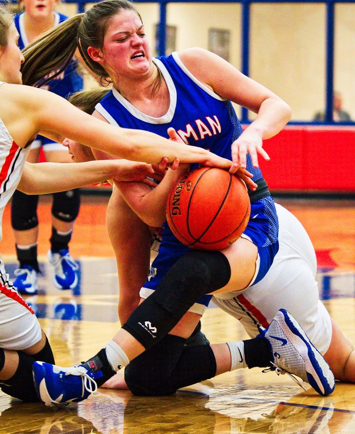 Madyson Pence of Quitman wrestles for possession in the Lady Bulldogs' bidistrict playoff game with DeKalb last Thursday night.