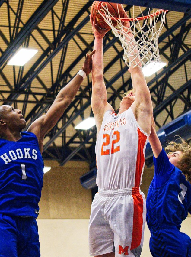 Dawson Pendergrass splits the Hornet defenders to dunk the ball for two of his 17 points.