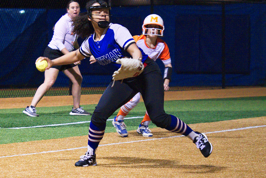Ashely Davis of Quitman fakes a throw to first base before turning to trap the Mineola runner on third. The throw to third was dropped allowing the Mineola runner to score. (Monitor photo by Sam Major)
