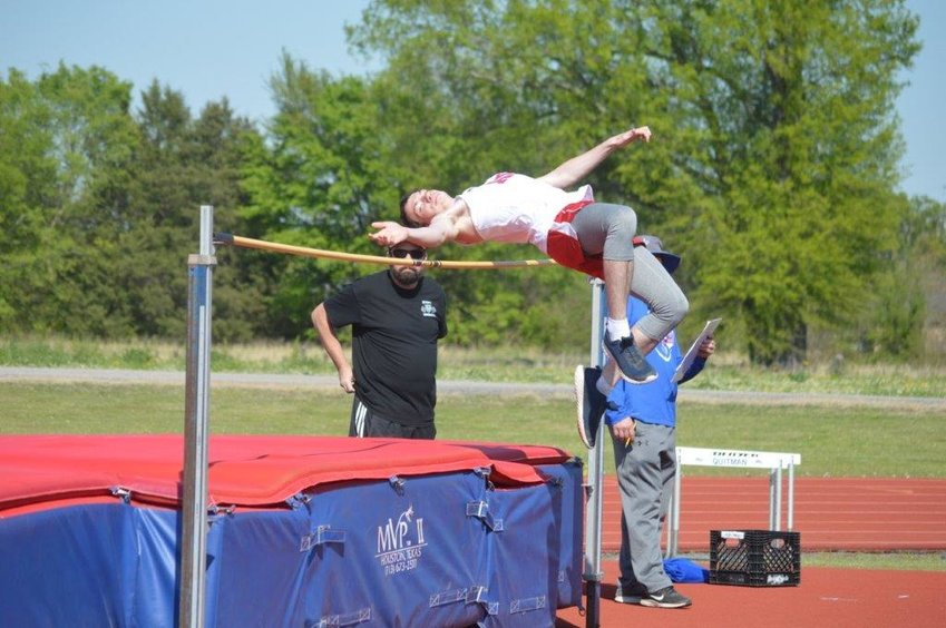 Alba-Golden's Sebastian Sanford flies over the bar competing in the high jump at the Quitman Track Meet held last Thursday. (Monitor photo by Larry Tucker)