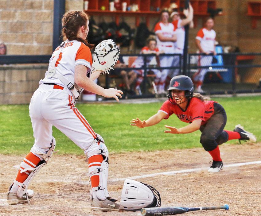 A Chapel Hill baserunner scores the winning run on a bases-loaded squeeze play in the top of the seventh inning last Tuesday. The Lady Jackets fell 3-1 in a low-scoring pitching duel.