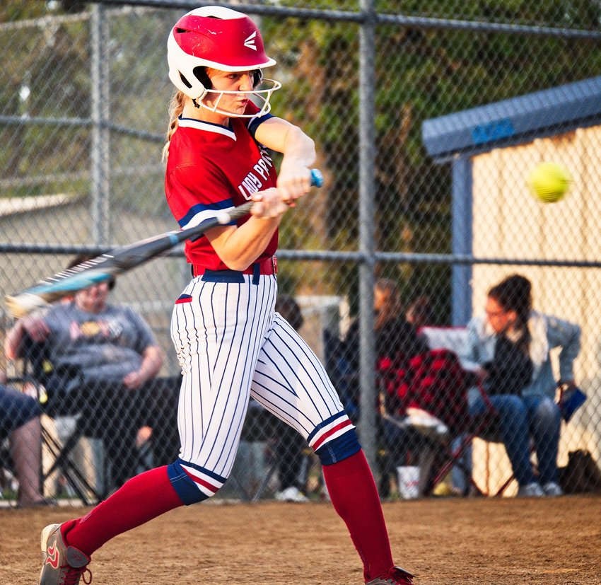 Cacie Lennon squares the bat up for one of her two hits against Fruitvale.