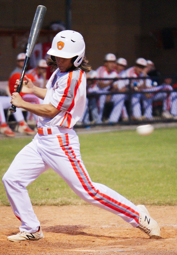 Riley Fowler tries to avoid an inside pitch but took one for the team and was awarded first base for Mineola.
