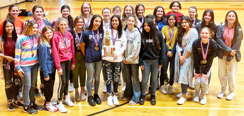 The Mineola girls junior high track team captured the district championship at last week's district meet. They were joined by the seventh grade boys and eighth grade girls in second place.