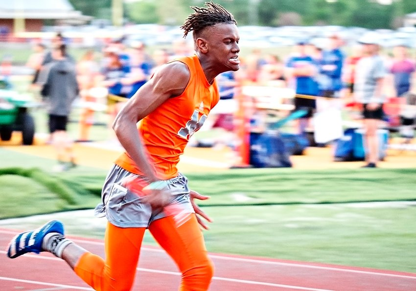 Jamarcus Kennedy runs the 3rd leg of the 4x200 meter relay for the Yellowjackets, who set a new school record with a time of 1:30.57 seconds.