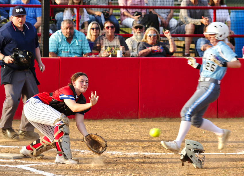 Lady Panther catcher Kayli Covey makes a nice scoop at the plate to secure a force out in second inning action against Como-Pickton.