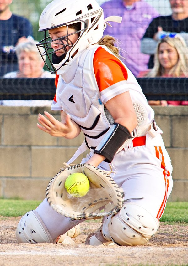 A wall behind home plate, Jaycee Smith rarely lets balls by her and has a knack for gunning down runners.
