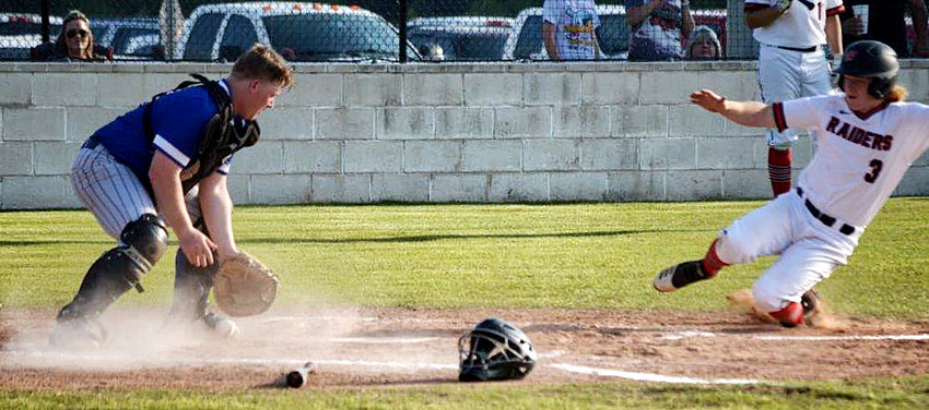 Quitman catcher Cody Hawley tries to dig a ball out the dirt in a close play at home against Winnsboro.