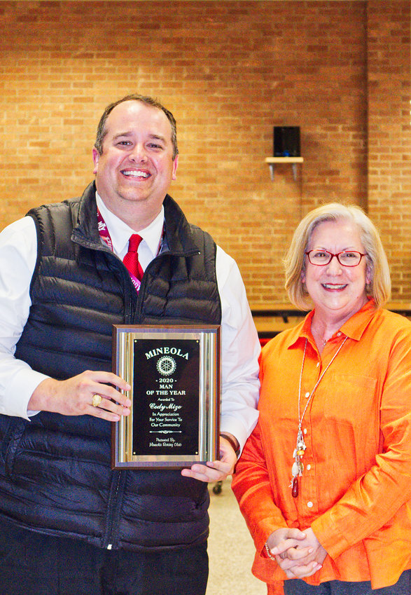Mineola School Superintendent Cody Mize was named Mineola Man of the Year at Monday night's school board meeting. Club President Denise Hurst presented the honor.