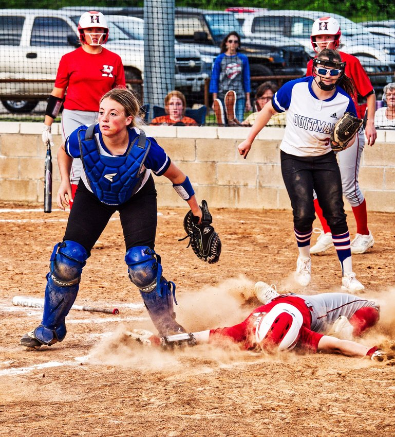 Senior catcher Kynlee Love won this battle at the plate, tagging out the Harmony base runner, as pitcher Alexis O'neal backs her up on the relay throw from senior Lindsey Hornaday.