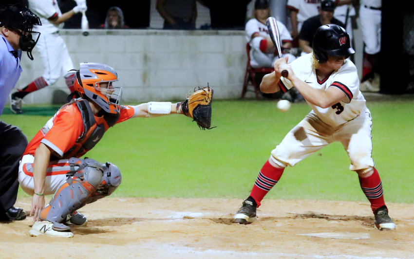 This photo sums up the outcome of Tuesday's Mineola vs Winnsboro game, as Yellowjacket starter Spencer Joyner threw a masterful game. Catcher Coy Anderson receives the pitch.