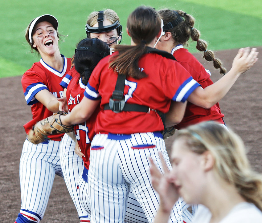 The celebration begins for Alba-Golden's area softball victory.