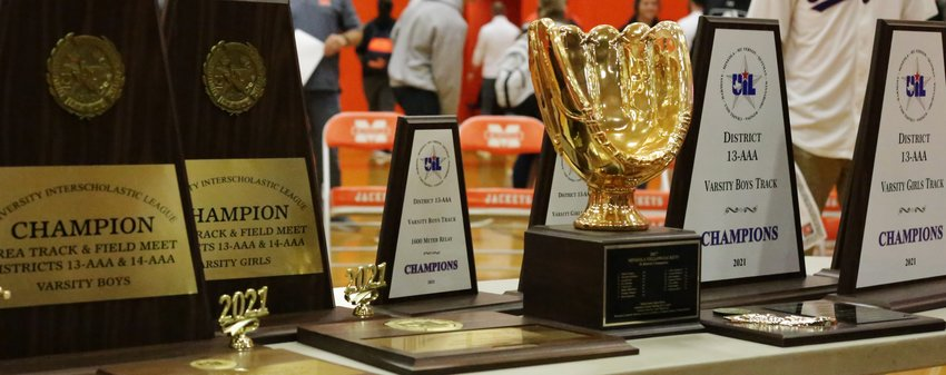 Some of the trophies captured by Mineola athletes this spring were on display at the assembly.
