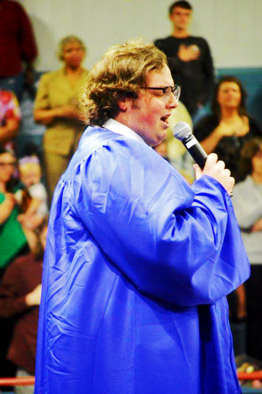 2021 grad Bobby Irwin sings the National Anthem at the Quitman High School graduation Friday.