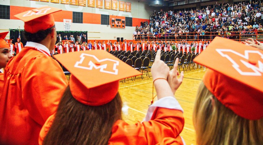 The newly-minted Mineola alumni sing their alma mater together as a class one last time.
