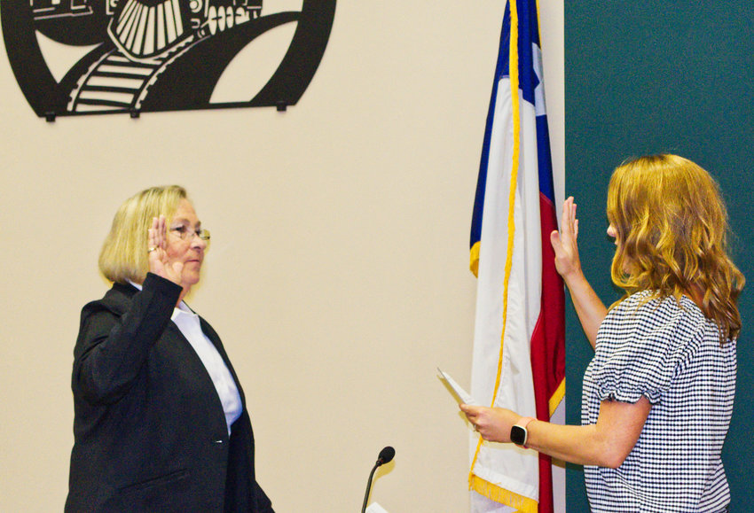Jayne Lankford, left, is sworn in as mayor of Mineola Monday by City Secretary Cindy Karch.