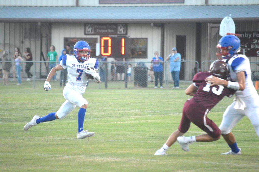 Quitman's Jack Tannebaum (7) gets a key block from Ethan Presley (18) which turned into a 56 yard touchdown.