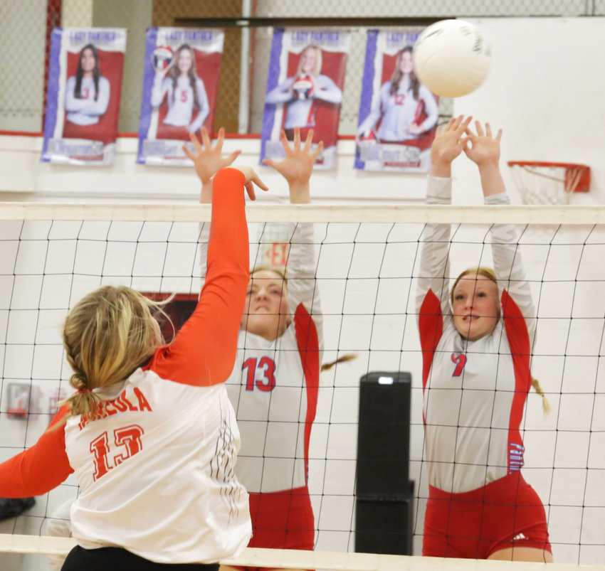 Action at the net was furious at Friday's Alba-Golden vs Mineola match. Here Lady Panthers Cacie Lennon and Kaylee Anglin defend a Jocelyn Whitehead kill attempt.
