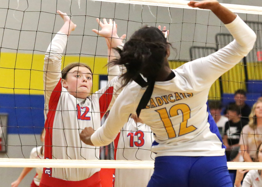 Lady Panther Alexis Wilmut rises up to challenge Big Sandy at the net.