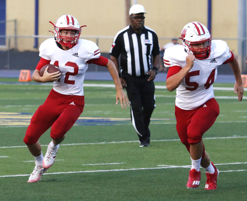Tyler Perez leads Thai Peterson around the corner in early action against Big Sandy. (Monitor photo by John Arbter)