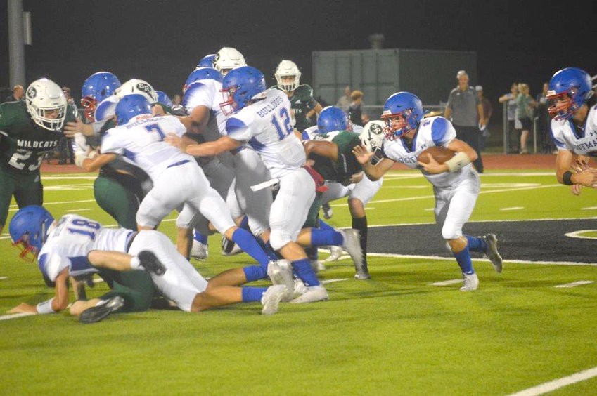 Quitman's Ford Tannebaum (2) follows the blocking of Ethan Presley (18), Jack Tannebaum (7) and Wyatt Hightower (12) in Friday's game at Surry-Rosser.