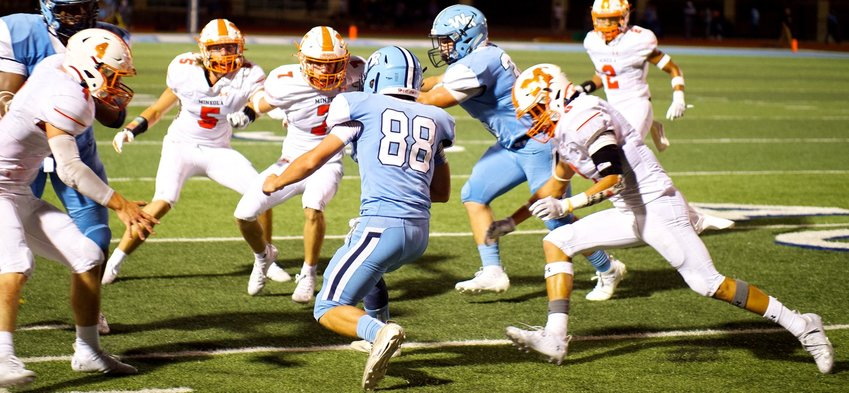 Mineola Yellowjackets, from left, Coy Anderson (4), Brady Shrum (5), Adam Blalock (7) and Julian Ramos (6) converge on the West Rusk ball carrier.