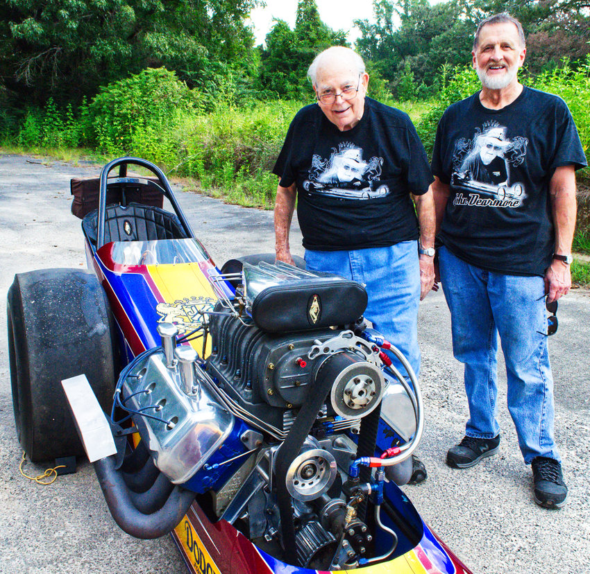 John Dearmore, left, with Keith Redfearn and Dearmore's restored 1970 top fuel dragster. Dearmore is celebrating 65 years in the racing business with a final tour.