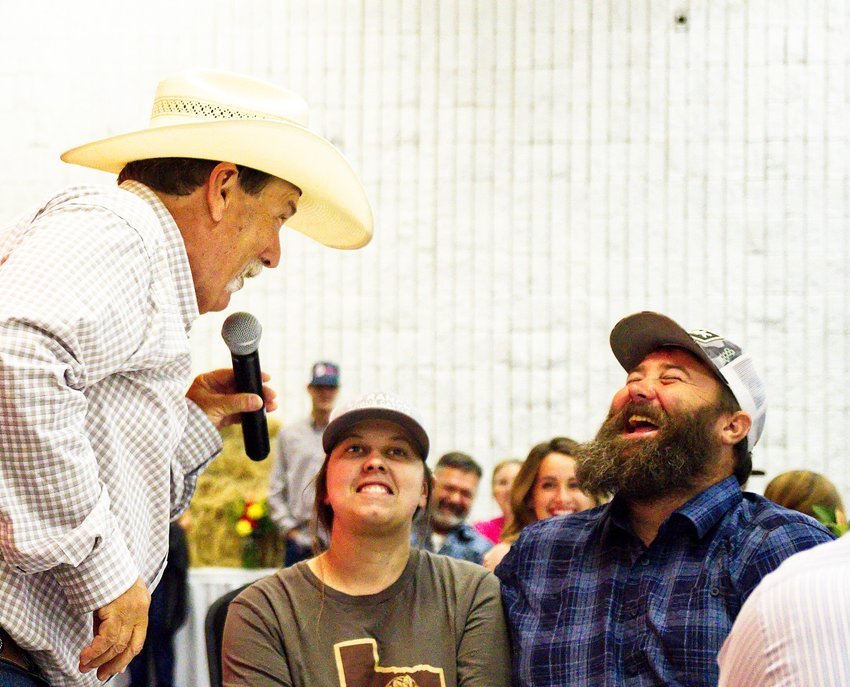 Kelly Conley (left) auctions off the thermal hog hunt offered by Trey Huff (right).