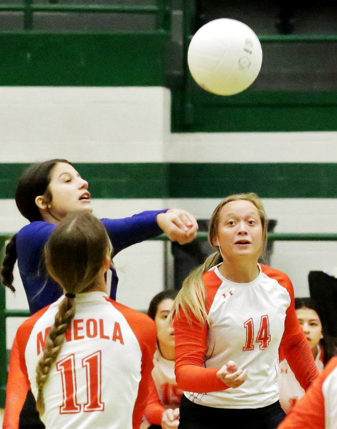 Kenleigh Aguirre makes a play on the ball between Lady Jackets Olivia Hughes (left) and Riley Weekly.