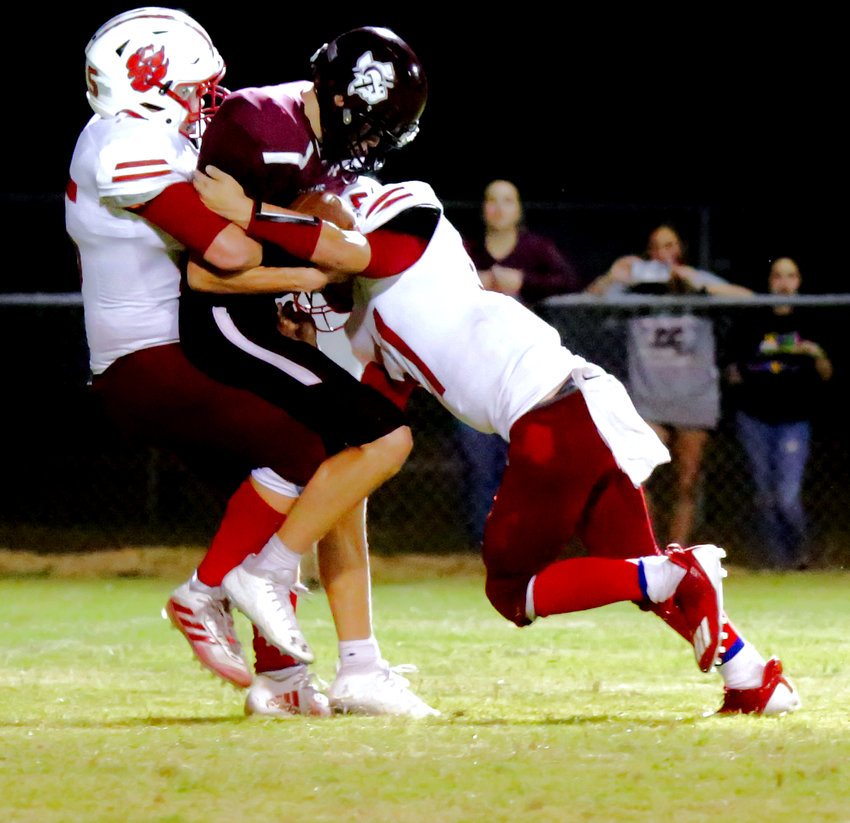 Michael Gaskill (left) assisted by Jason Langston makes the game-sealing sack of the Cumby quarterback on a fourth down to preserve the win.